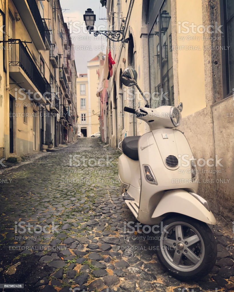 Vespa parked on old Lisbon street, Portugal stock photo