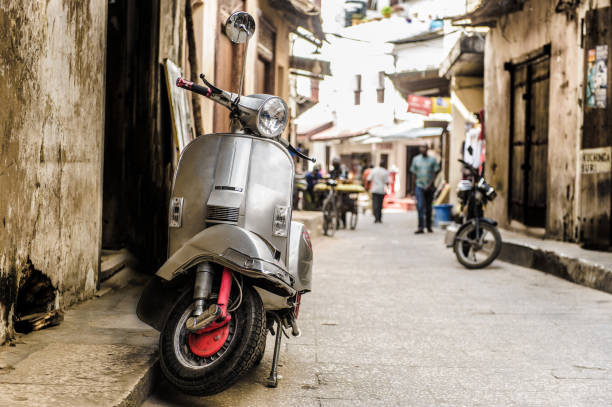 Vespa parked on old Stone Town street, Zanzibar stock photo