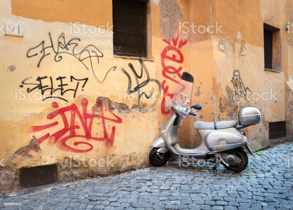 Vespa Scooter And Graffiti In An Alley In Trastevere Rome Italy Royalty Free Stock