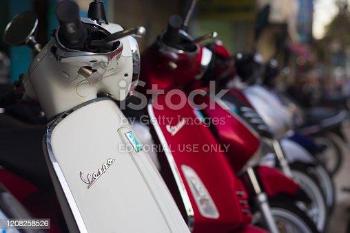 Hanoi, Vietnam - february 20, 2020: Vespa the famous Italian brand of scooter manufactured by Piaggio. Selective focus on Vespa name, white new elegant model. Showroom in Hanoi, Vietnam