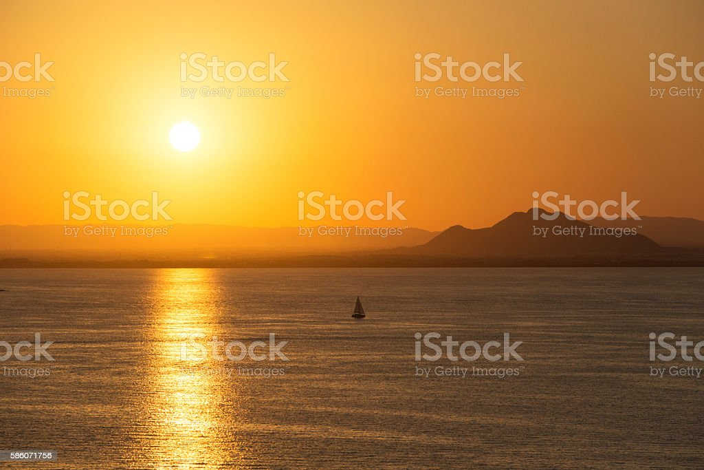 Vessel Sailing at Sunset La Manga del Mar Menor, Spain stock photo