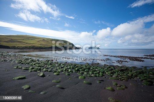 istock Vestmannaeyjar island beach day view, Iceland landscape. Alsey island 1306539146