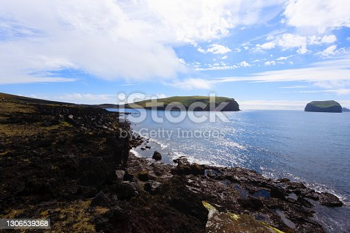 istock Vestmannaeyjar island beach day view, Iceland landscape. Alsey island 1306539368