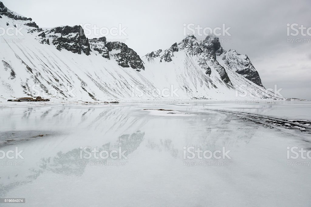 Vestrahorn mountains, reflection in the frozen water, Stokksnes Peninsula, Iceland stock photo