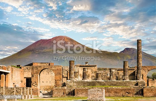 Ancient walls in Pompeii with volcano Vesuvius in the background