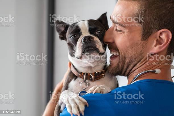 Vet cuddling pet dog picture id1158247958?b=1&k=6&m=1158247958&s=612x612&h=egyae7cj22z 6pgvqe3wtbrsvzjobkyfimht8nrhe1c=