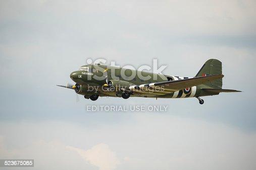 Fairford, UK - 12 July, 2014: Veteran Douglas DC3 'Kwicherbichen' in flight and displaying at the Royal International Air Tattoo.