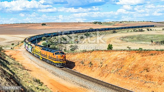 Crystal Brook, Australia - Nov 3, 2020: Veteran EMD diesel locomotive CLP17 leads a trainload of grain heading to port and export. GWA (One Rail Australia) rounding the curves at Huddleston in South Australia's Mid-North