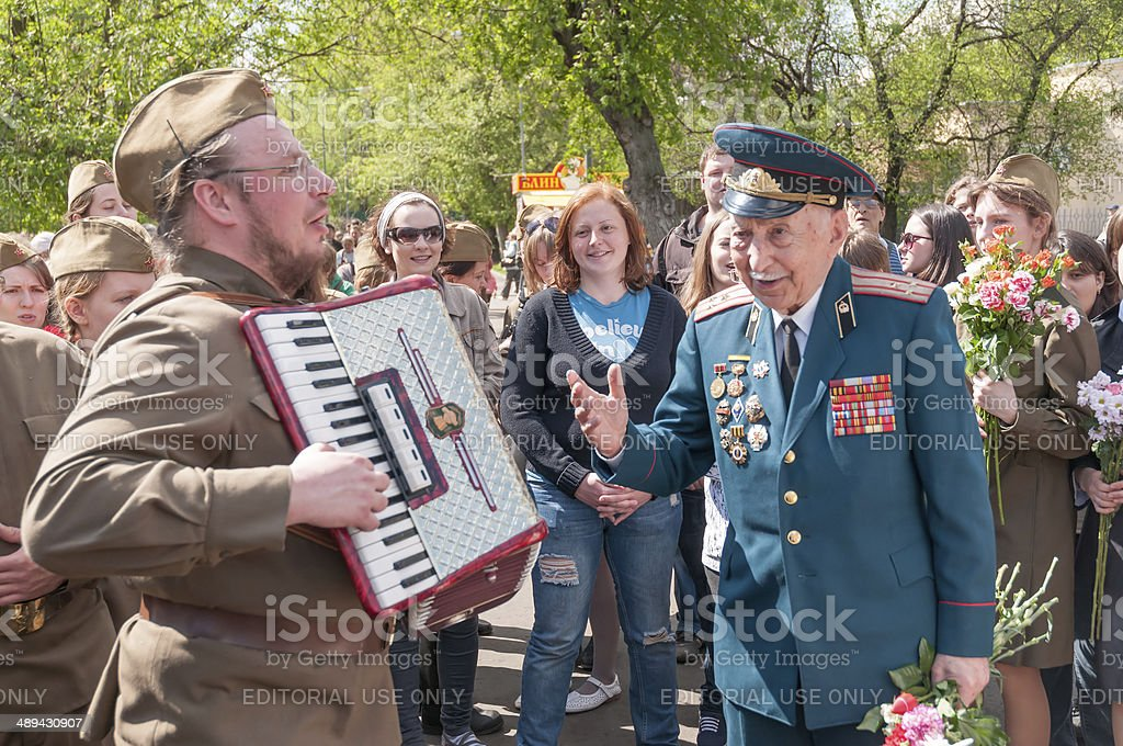 Veteran of war and accordion player in WWII uniform stock photo