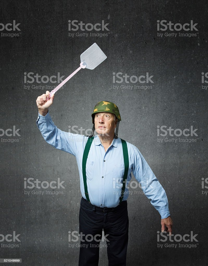 veteran soldier with weapon for kill mosquito stock photo
