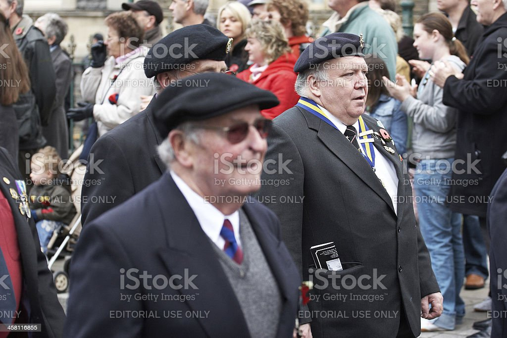 Veteran soldiers with medals marching at remembrance day parade royalty-free stock photo
