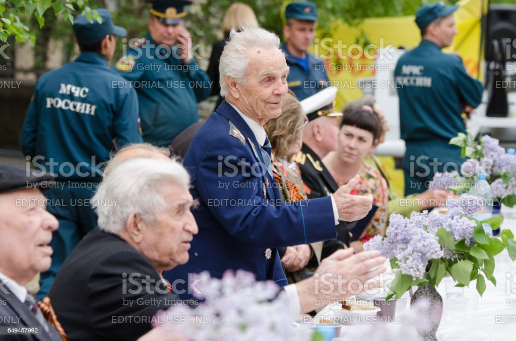 Veterans are invited to the festive table stock photo