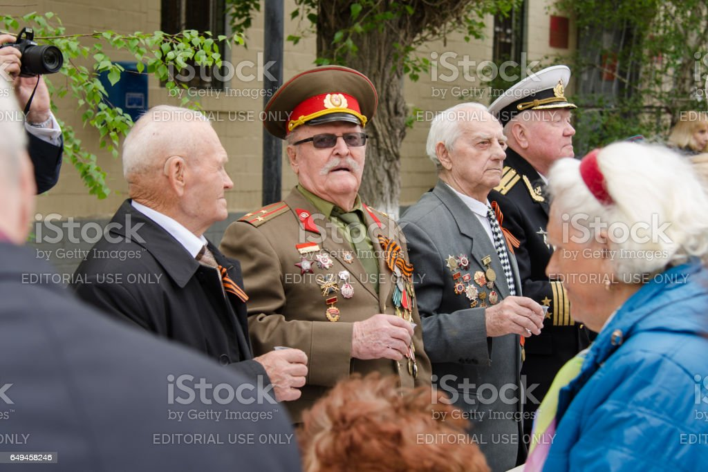 Veterans commemorate fallen soldiers standing at a gala event stock photo
