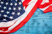 Veterans Day background. American flag on blue wood. Space for your text