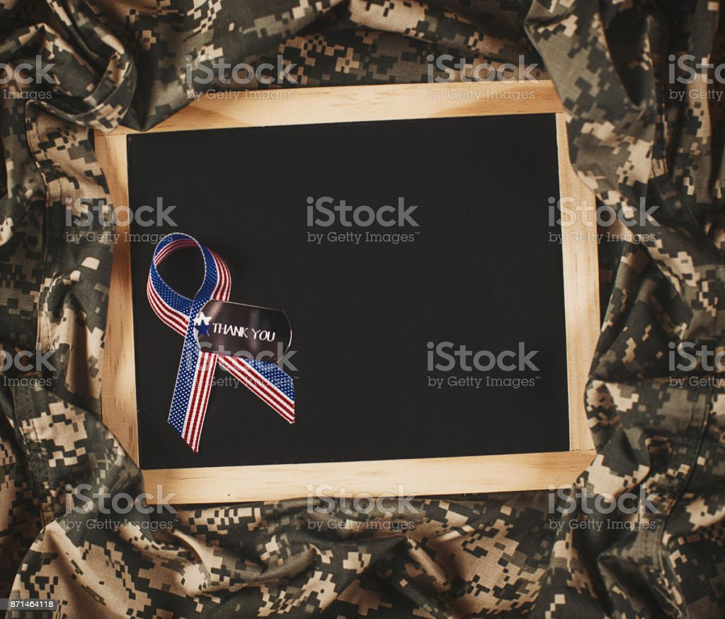 Veterans Day background. Military uniform with dog tags stock photo