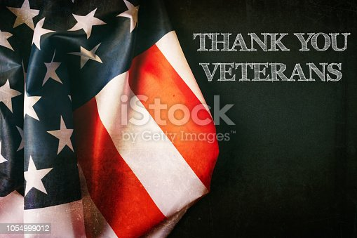 istock Veterans day background with text and USA flag 1054999012