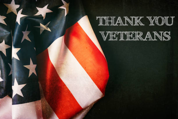 veterans day background with text and usa flag - veterans day стоковые фото и изображения