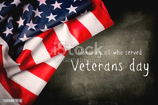 istock Veterans day background with text and USA flag 1055887818