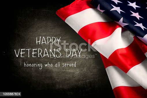 istock Veterans day background with text and USA flag 1055887824
