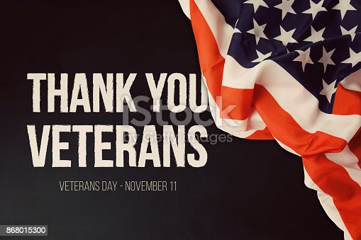 istock Veterans day background with text and USA flag 868015300