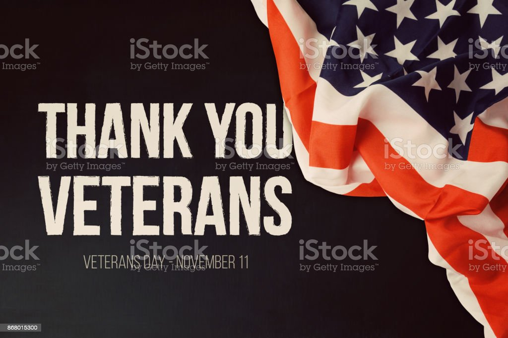 Veterans day background with text and USA flag stock photo