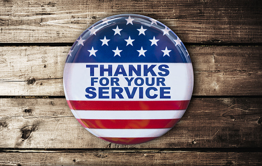istock veterans day badge on a plank table 686918434
