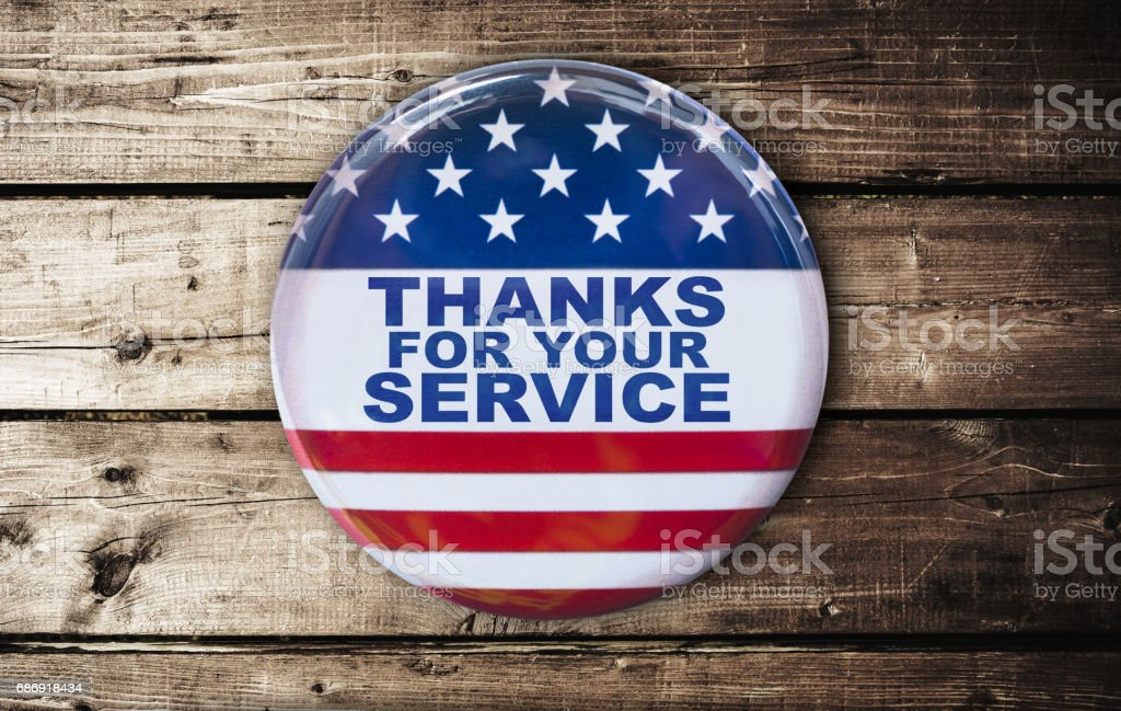 veterans day badge on a plank table stock photo