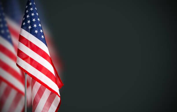 veterans day concept of usa flag on green background - veterans day стоковые фото и изображения