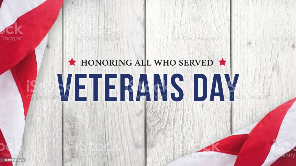 Veteran's Day - Honoring All Who Served Text Over White Wood stock photo