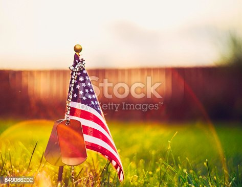istock Veteran's Day in America. American flag and military dog tags 849066202