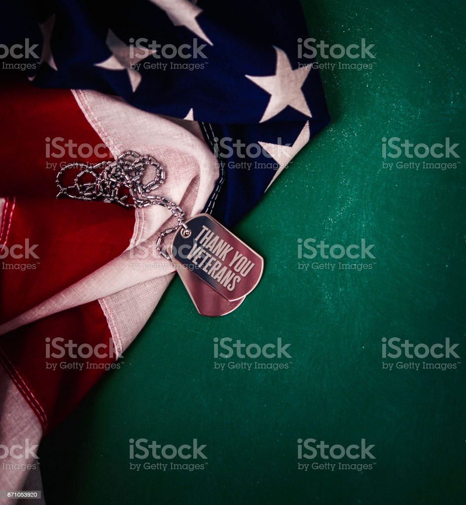 Veterans Day in America. American flag on chalkboard with message stock photo