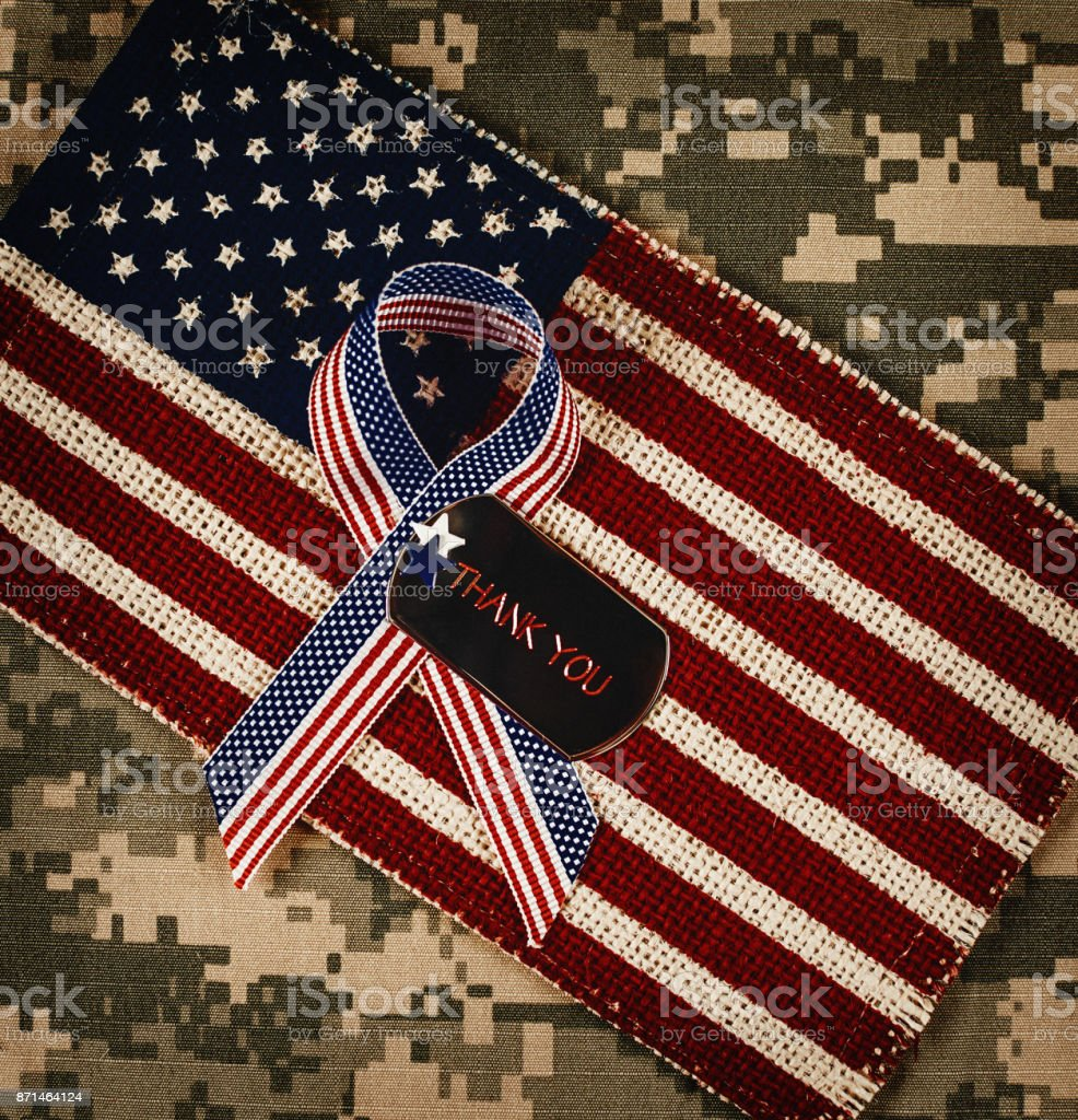 Veterans Day in America. American flag with dog tags stock photo
