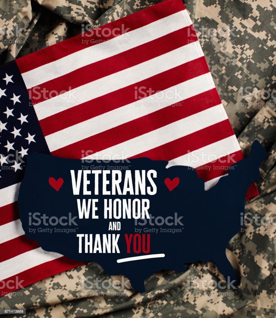 Veterans Day in America. American flag with military uniform stock photo