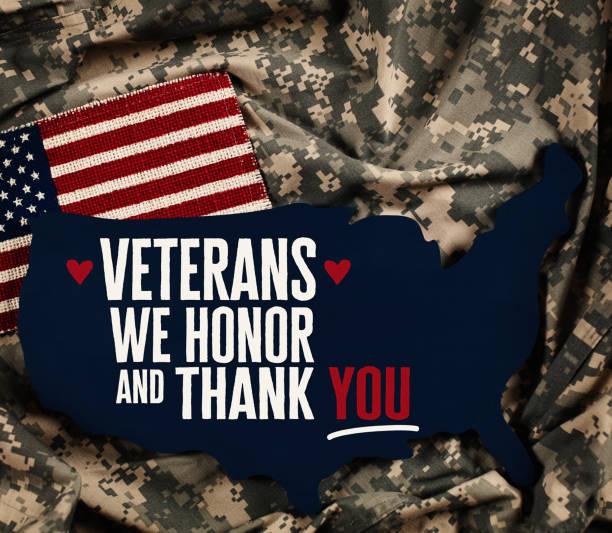 veterans day in america. american flag with military uniform - veterans day стоковые фото и изображения