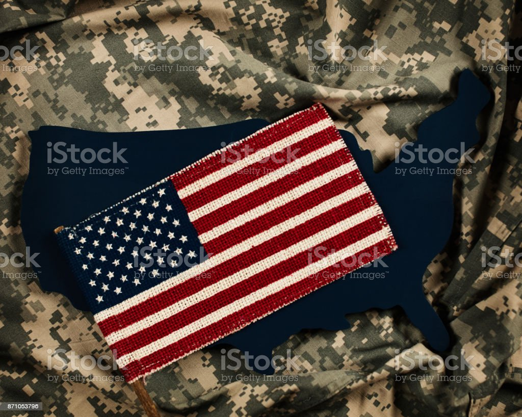 Veterans Day in America. Flag and US military uniform stock photo