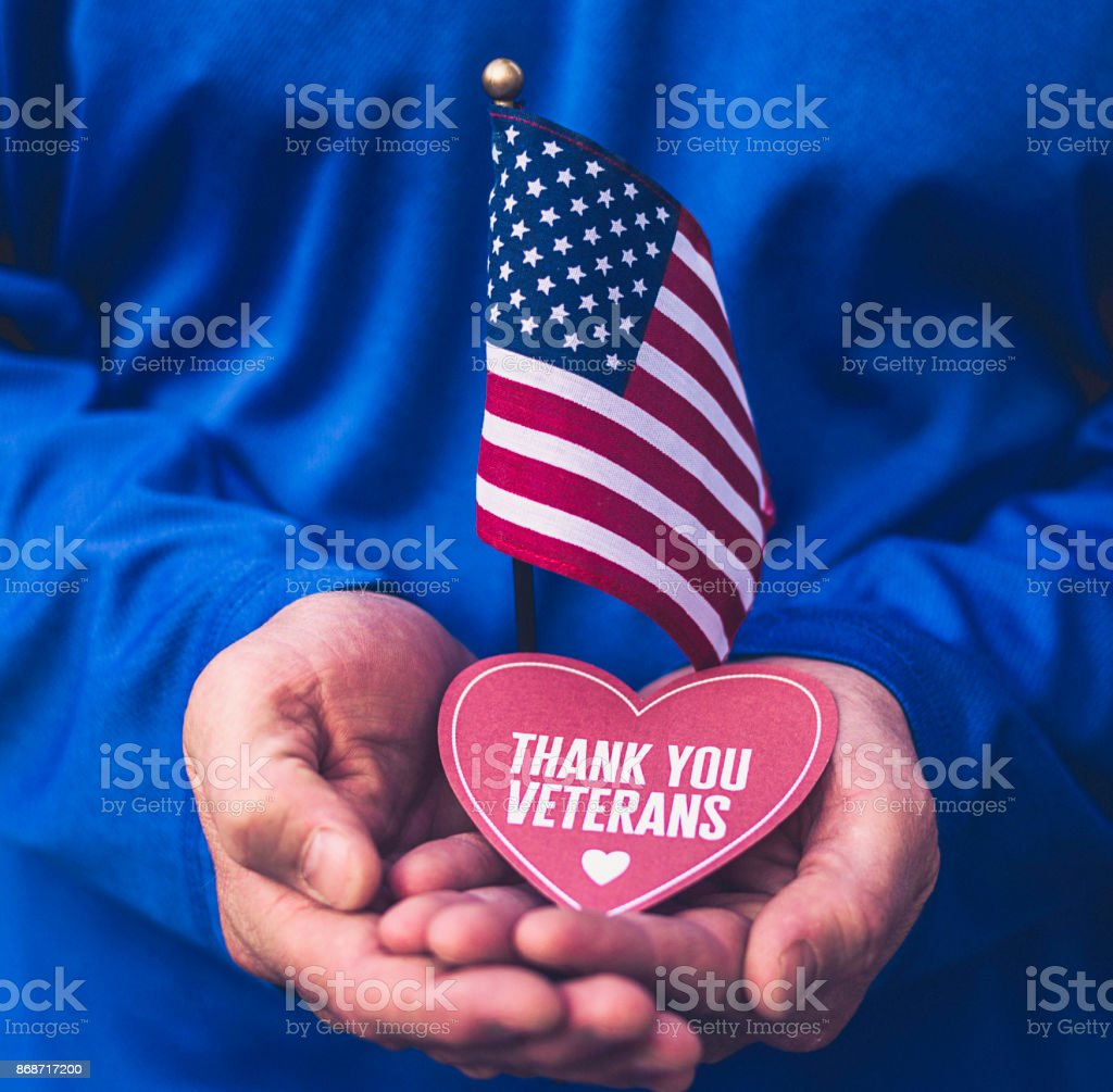 Veterans Day in America. Male hands holding thank you message stock photo
