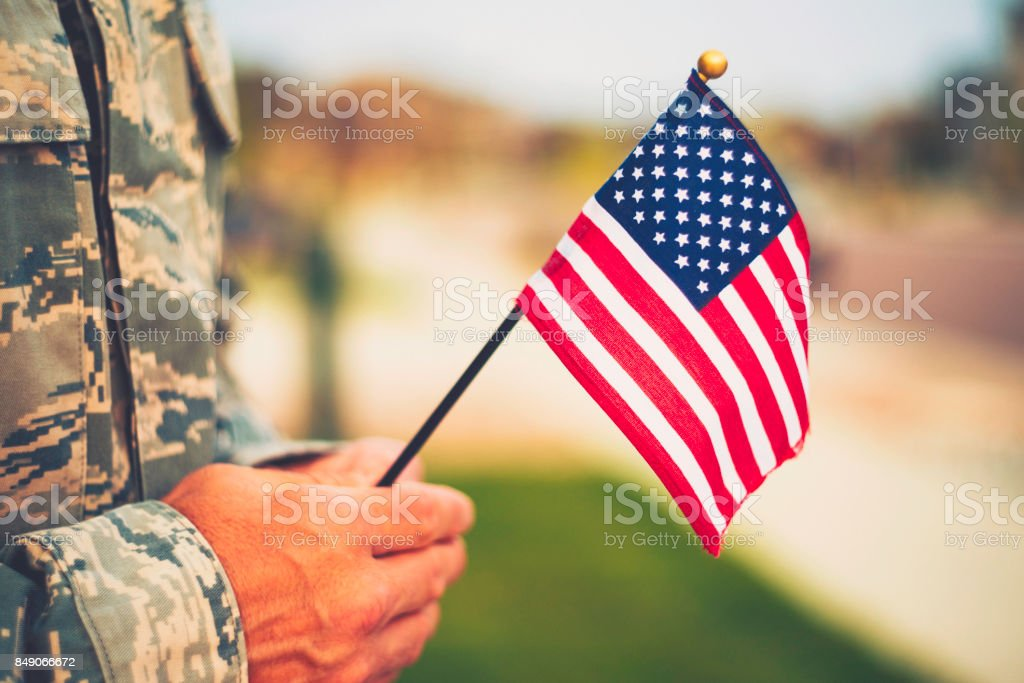 Veteran\'s Day in America. Soldier with American Flag