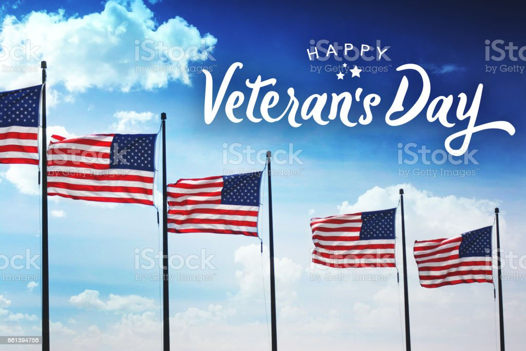 Veteran's Day Typography Over Flags Background stock photo