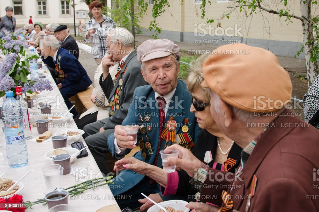 Veterans drink at a festive event stock photo
