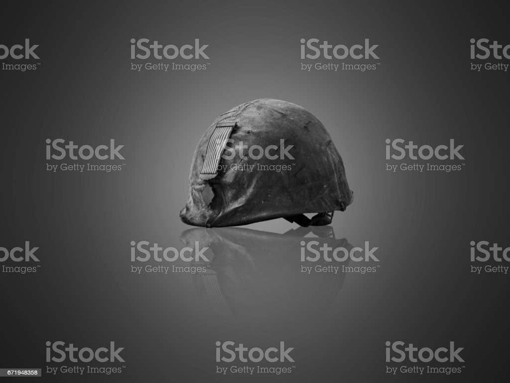 Veterans helmet, camouflage, medallion on gray background.black and white picture stock photo