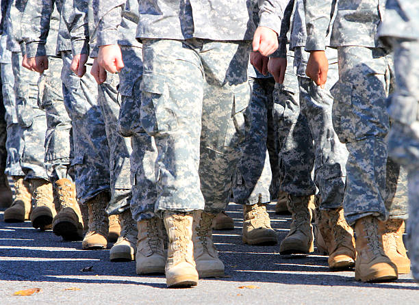 Veterans marching stock photo