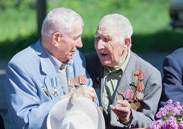 Veterans of World War II. Makeevka, Ukraine Makeevka Ukraine - May 7 2014: Veterans of World War II during the celebration of the anniversary of the victory over fascism mount combatant stock pictures, royalty-free photos & images