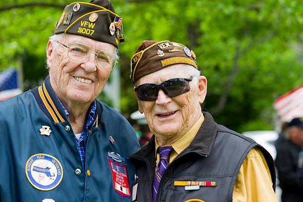 Veterans of World War II Veterans of World War II at a Memorial Day service. american culture stock pictures, royalty-free photos & images