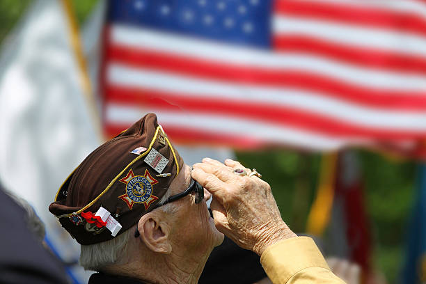 Veterans Saluting Veteran Salutes the US Flag independence day photos stock pictures, royalty-free photos & images