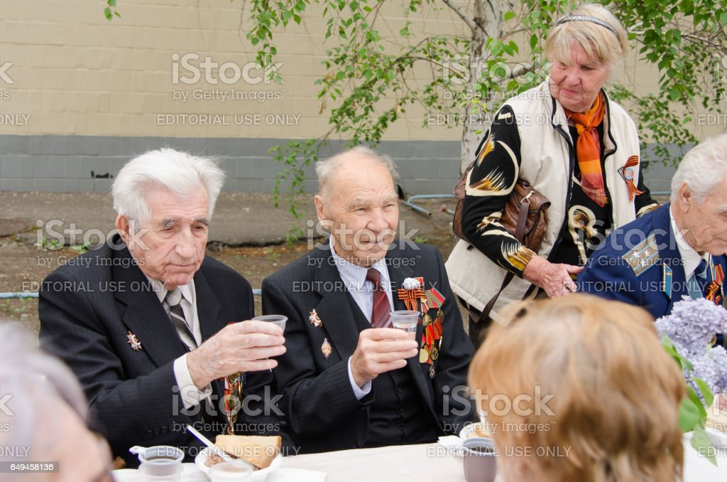 Veterans sitting at the festive table stock photo
