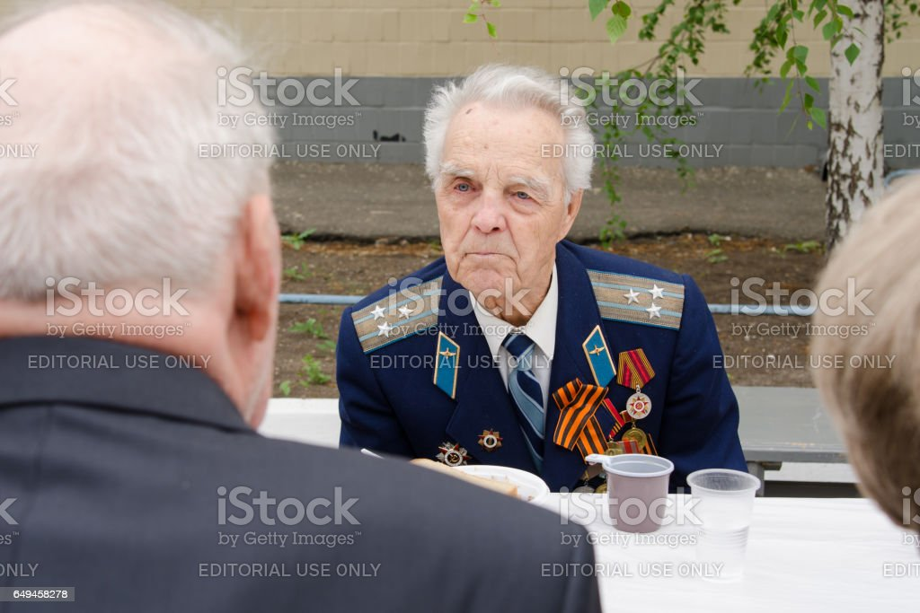 Veterans talk while sitting at table a gala event stock photo