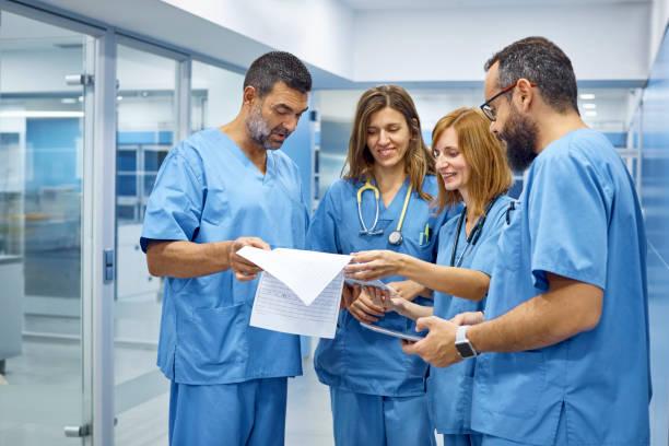 Veterinarians discussing over medical records picture id916855634?b=1&k=6&m=916855634&s=612x612&w=0&h=lglfgso1hfepdmgyebczrwbb9td4gefaq 33srdu07c=
