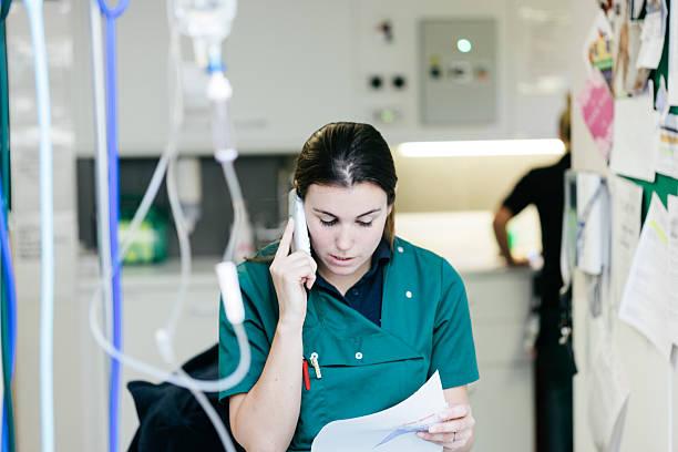 Veterinary Surgeon talking on the telephone stock photo
