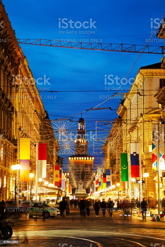 Via Dante shopping street with people at night stock photo