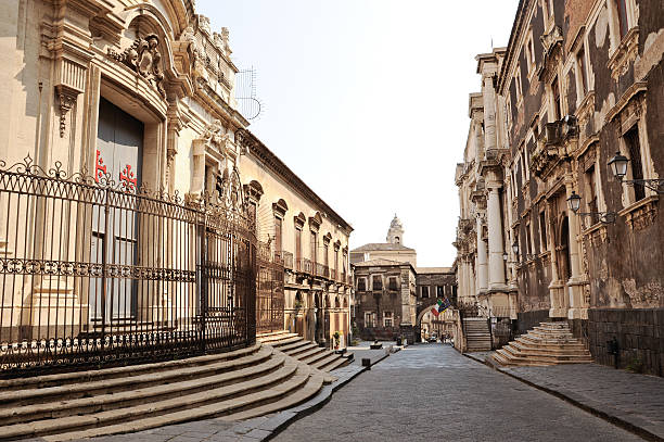 "Via dei Crociferi, Catania ""Crociferi street, Catania, Sicily, Italy. Church of San Francesco Borgia (right), Church of San Giuliano (left), Jesuit college (left)."" catania stock pictures, royalty-free photos & images"